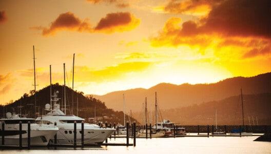 Superyacht berthing at sunset Coral Sea Marina