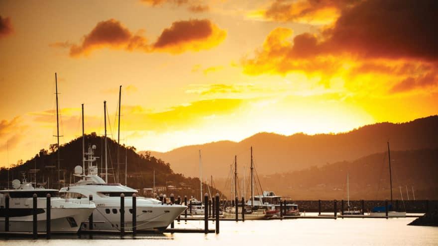 Superyacht berthing at sunset Abell Point Marina