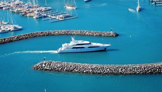 A superyacht entering Coral Sea Marina