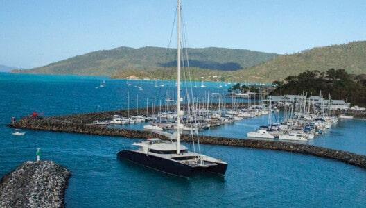 Superyacht sailing catamaran arriving into Coral Sea Marina