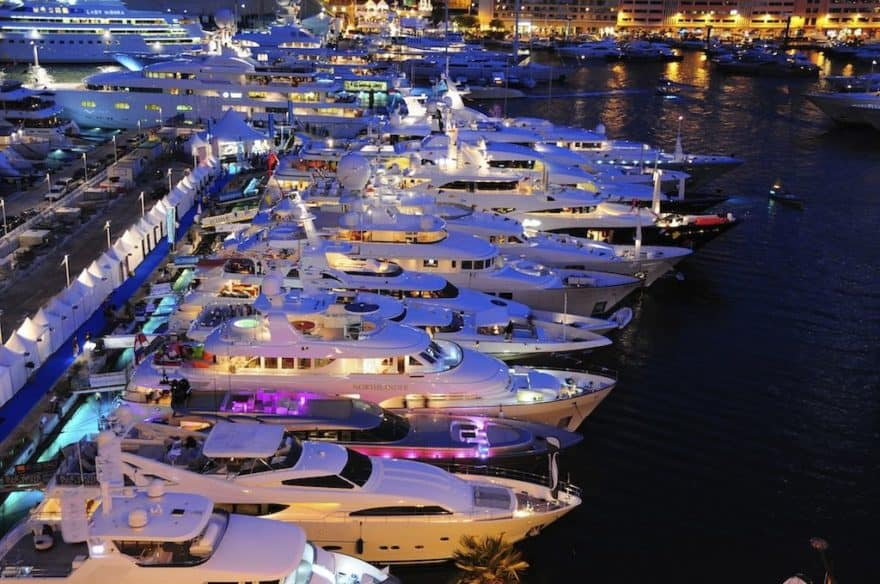 Aerial of the Monaco Yacht Show in Monaco with numerous superyachts all berthed in the marina