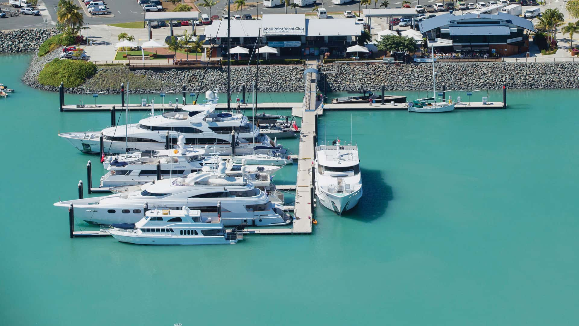 aerial of private superyacht arm at Coral Sea Marina with superyachts berthed