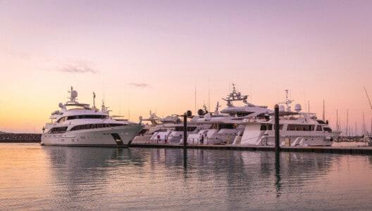 Superyachts berthed at Coral Sea Marina at sunset