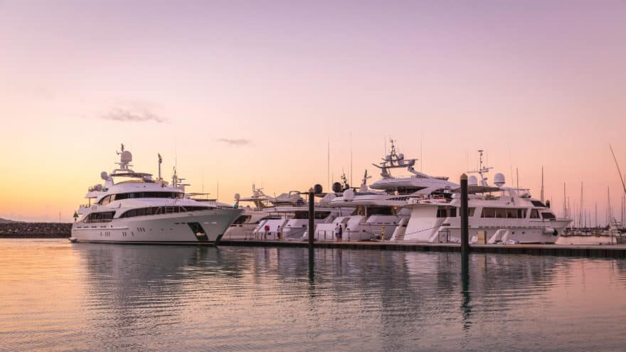 Superyachts berthed at Coral Sea Marina at sunset