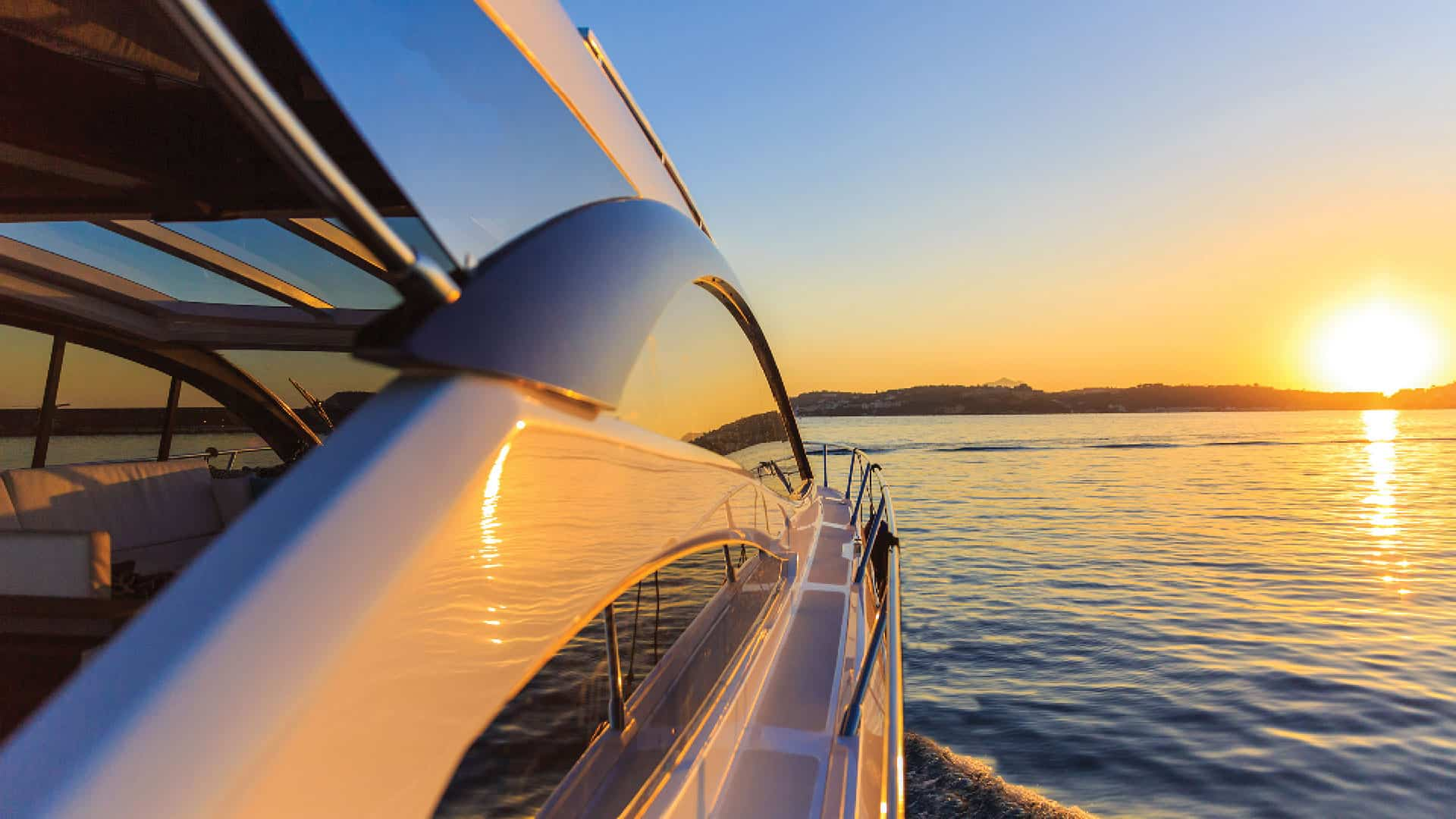 Superyacht cruising in the Whitsundays at sunset