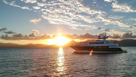 Superyacht cruising in the Whitsundays at sunset