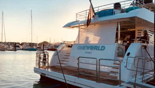 One World superyacht at sunset at Coral Sea Marina