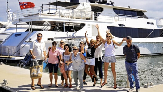 Superyacht Group Famil delegates 2019 jumping infront of Superyacht Sahanna