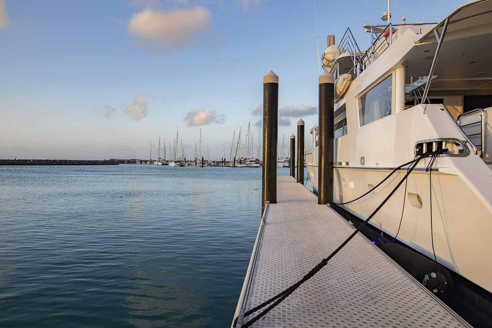 superyacht at sunset at Coral Sea Marina