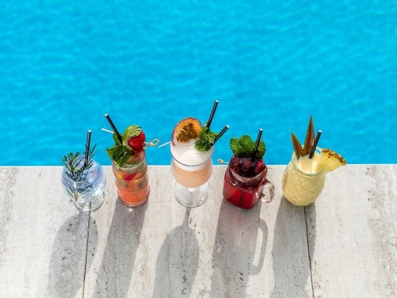 Five different tropical cocktails on display poolside at The Rocks, Coral Sea Resort Hotel