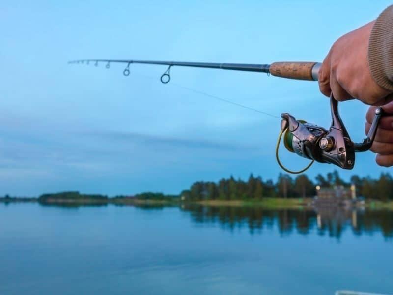 A man fishing at Lake Proserpine in the Whitsundays