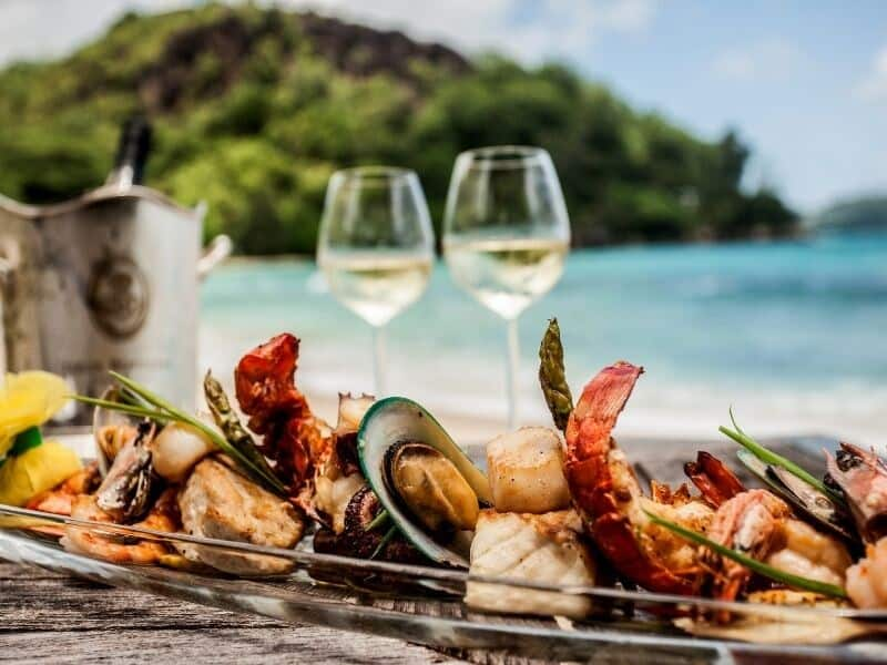 Seafood platter and wine on a beach