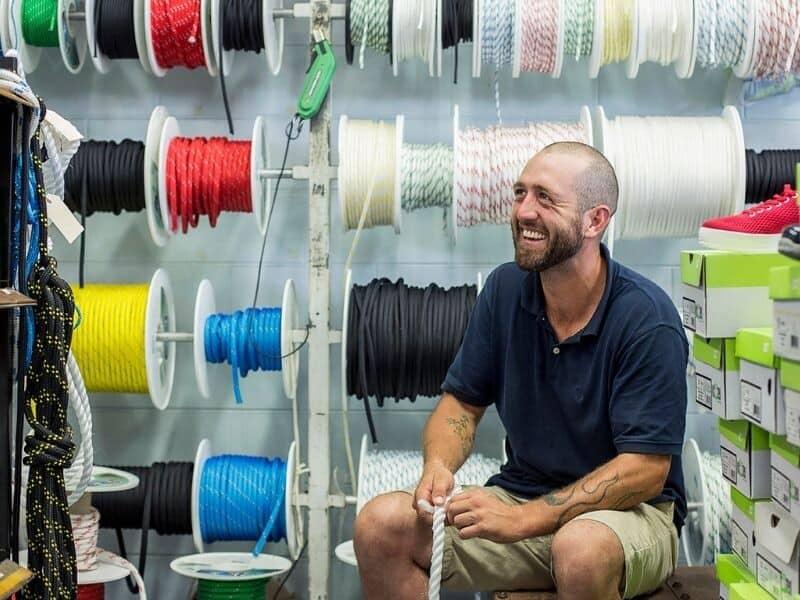 A man splicing rope in a workshop